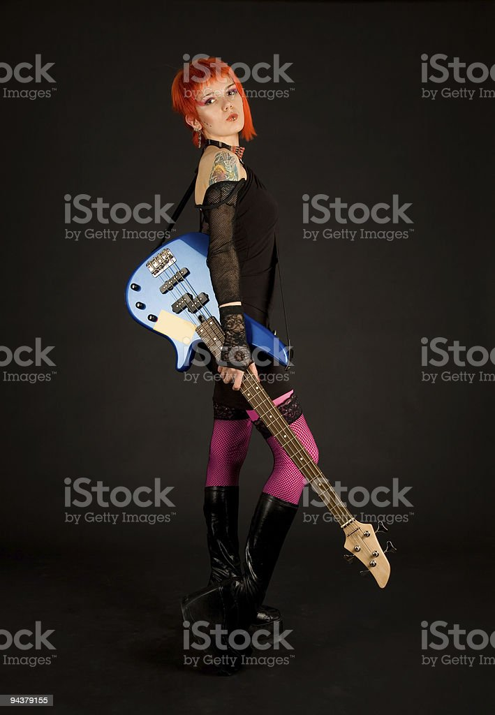 Rock girl with bass guitar royalty-free stock photo