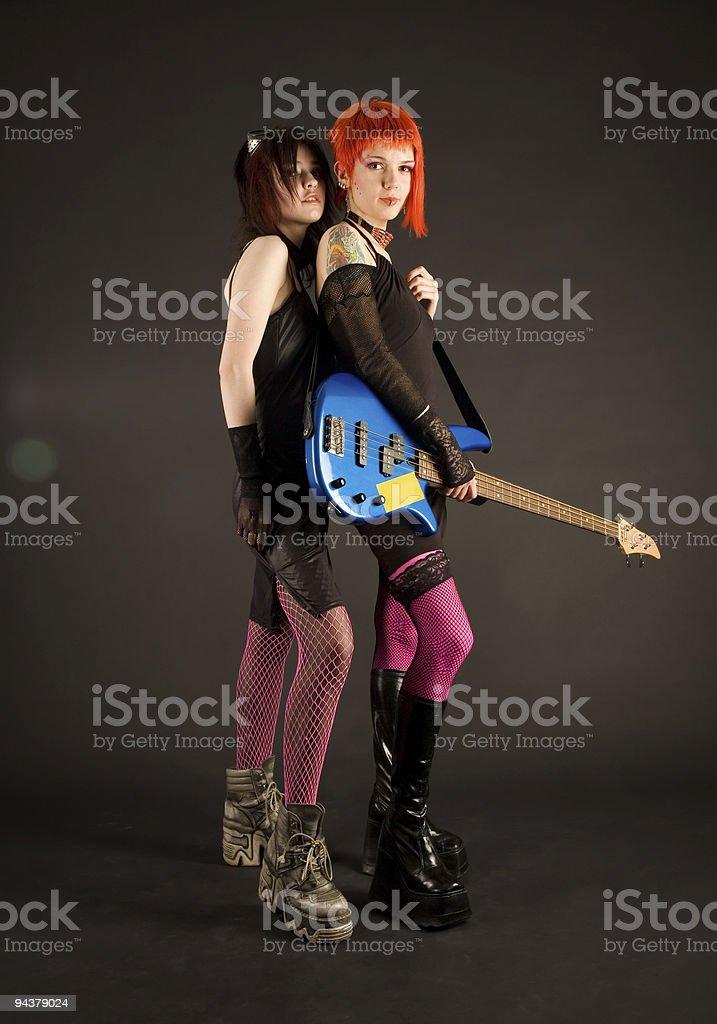 Rock girls with bass guitar stock photo