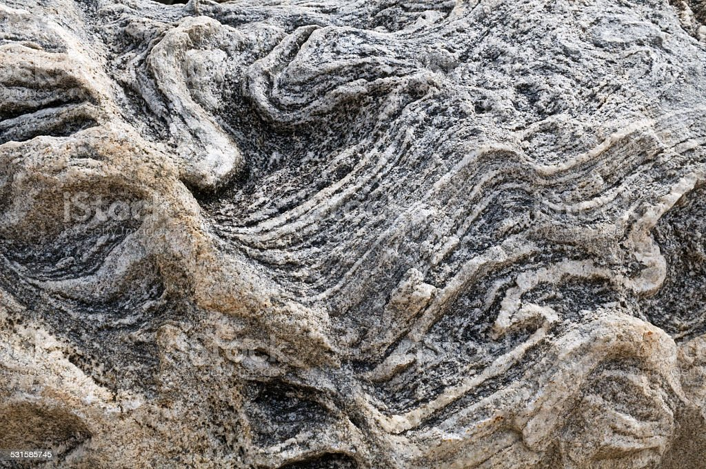 Rock gneiss close up. Natural stone. stock photo