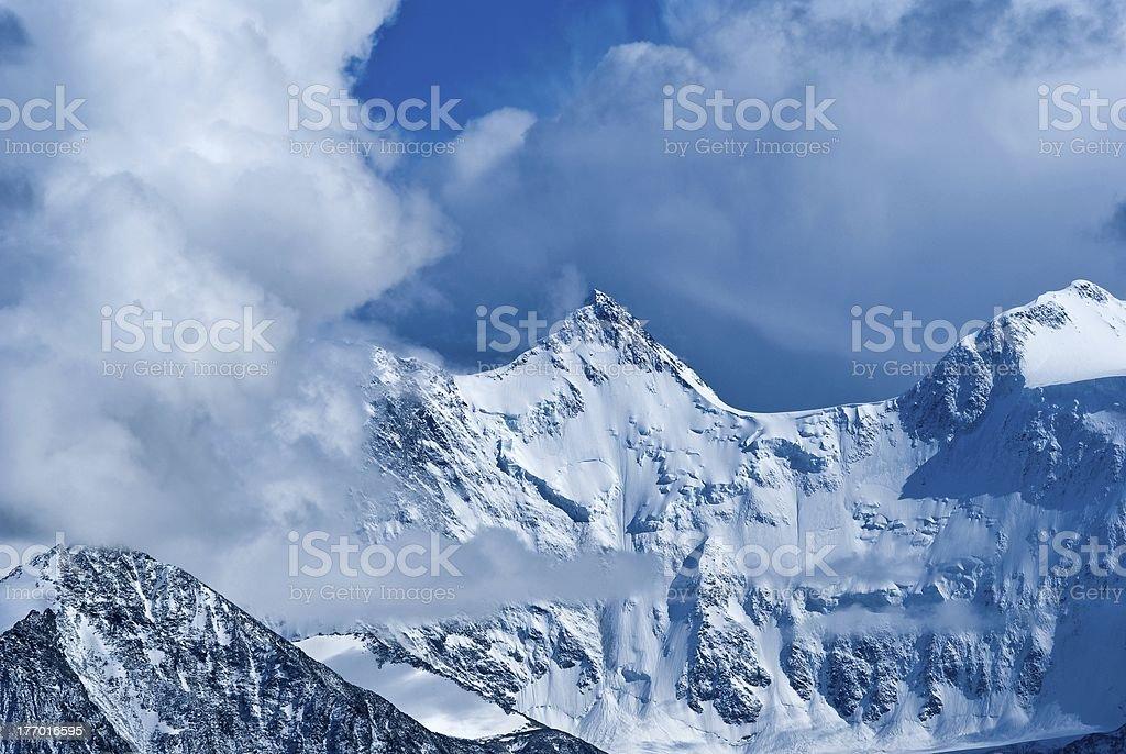rock in a clouds, altai russia stock photo