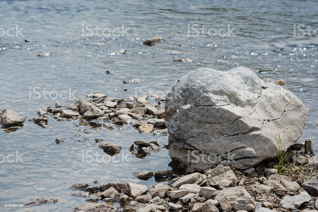 Rock in a river stock photo