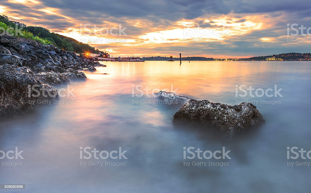 rock in Alki beach in the night time with reflect stock photo
