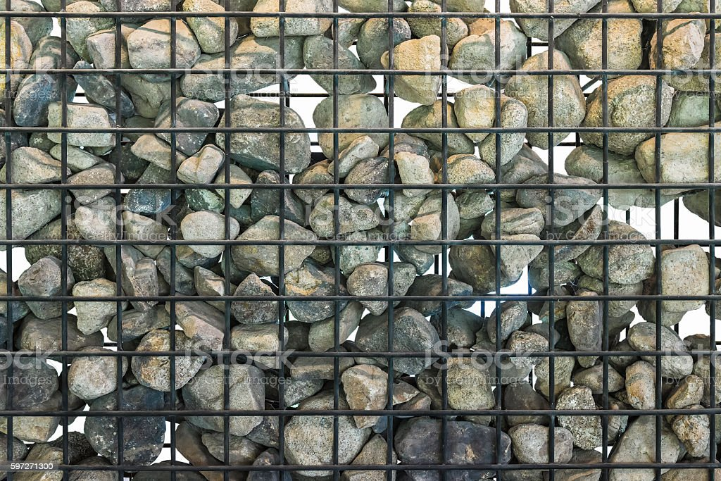 Rock in cage stock photo