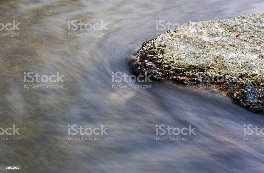 Rock in the creek stream royalty-free stock photo