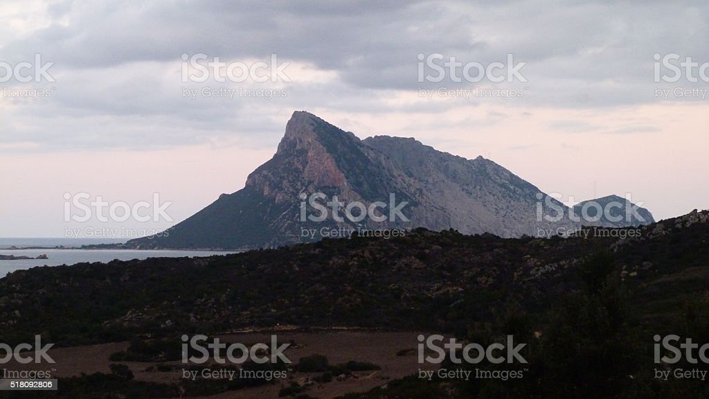 Rock in the sea after a thunderstorm in Sardegnia stock photo