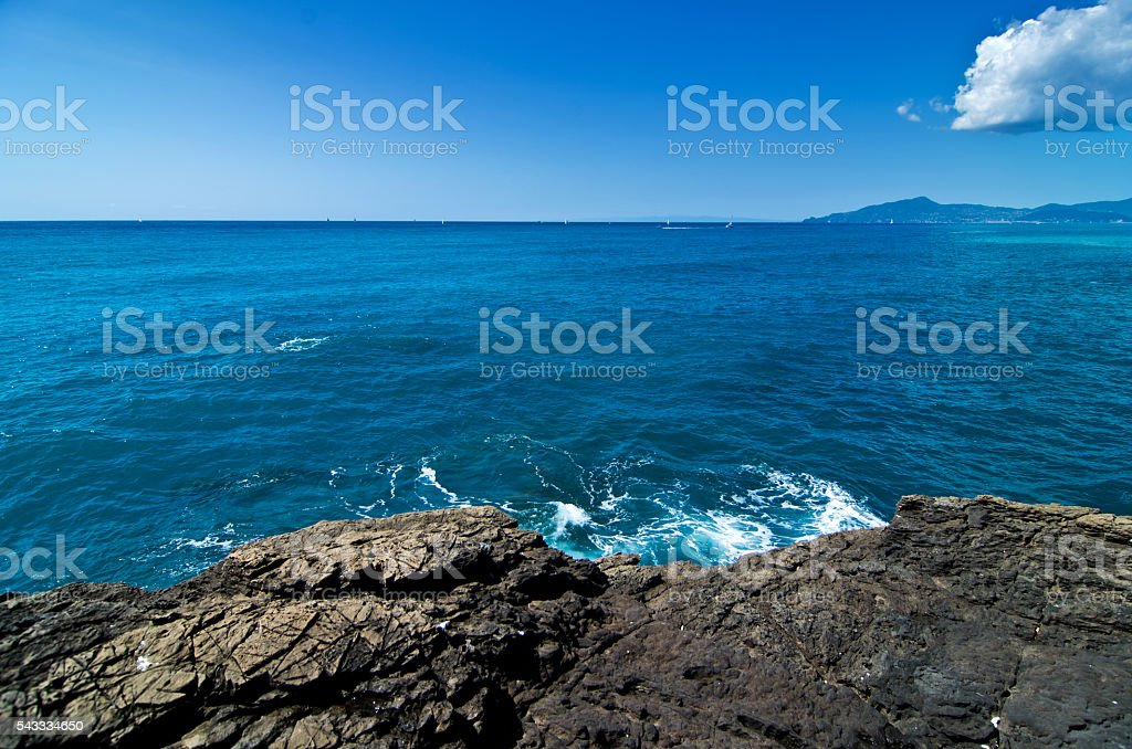 rock in the sea cliff stock photo