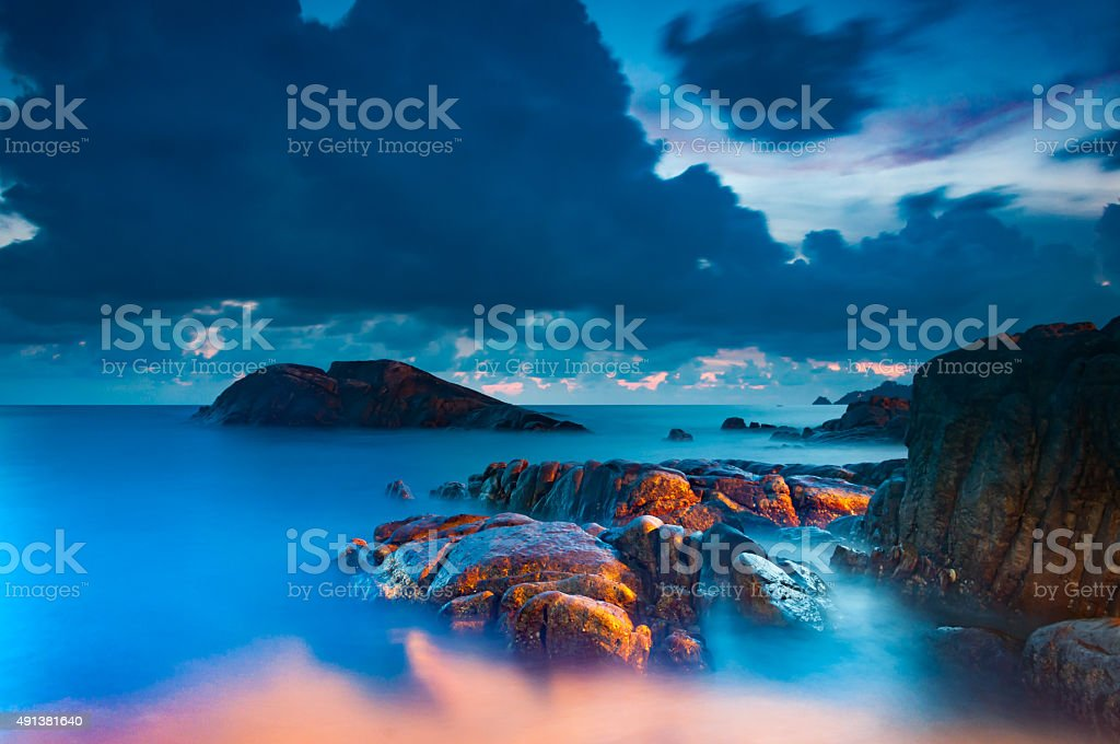 Rock in the sea with long exposure shooting stock photo