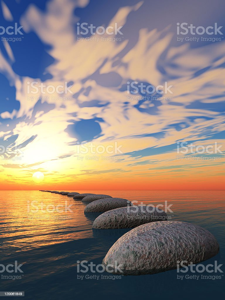rock in water and yellow sunset stock photo