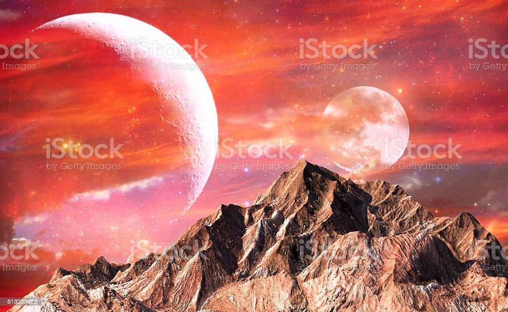 Rock mountain with red sky and twin moons as background stock photo