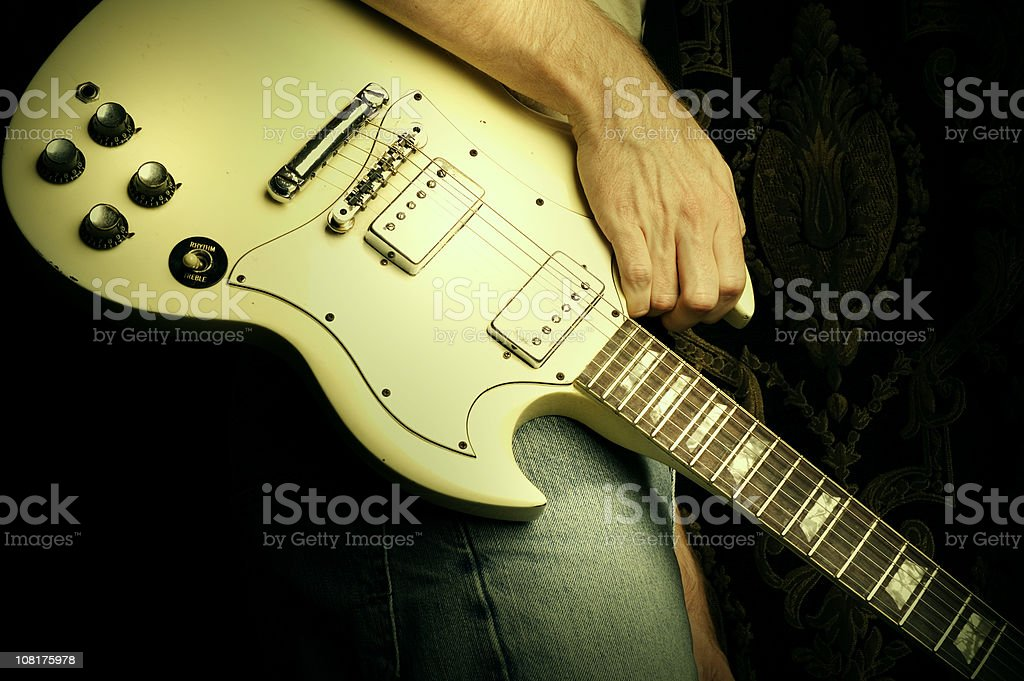 Rock 'n' roll white guitar stock photo