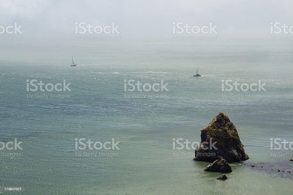 Rock, Ocean, and Sailboats royalty-free stock photo