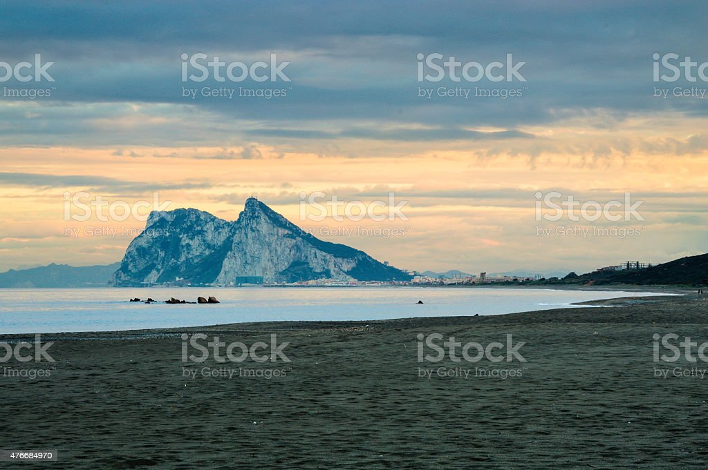 Rock of Gibraltar seen from the Alcaidesa beach on sunset. stock photo