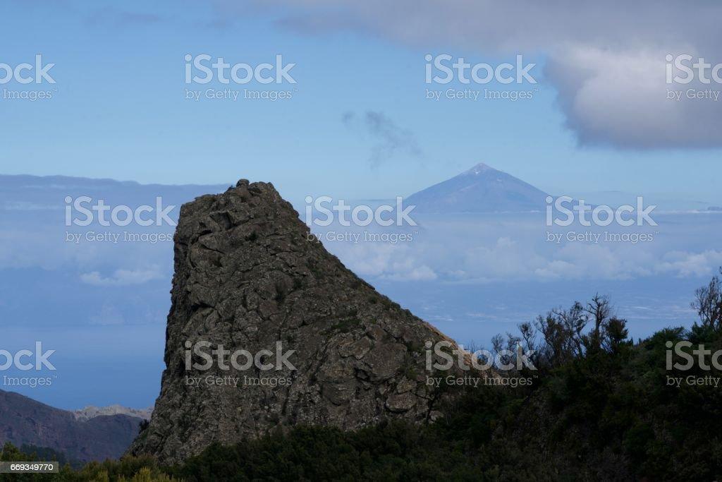 rock of La Gomera and mountain of El Hierro stock photo