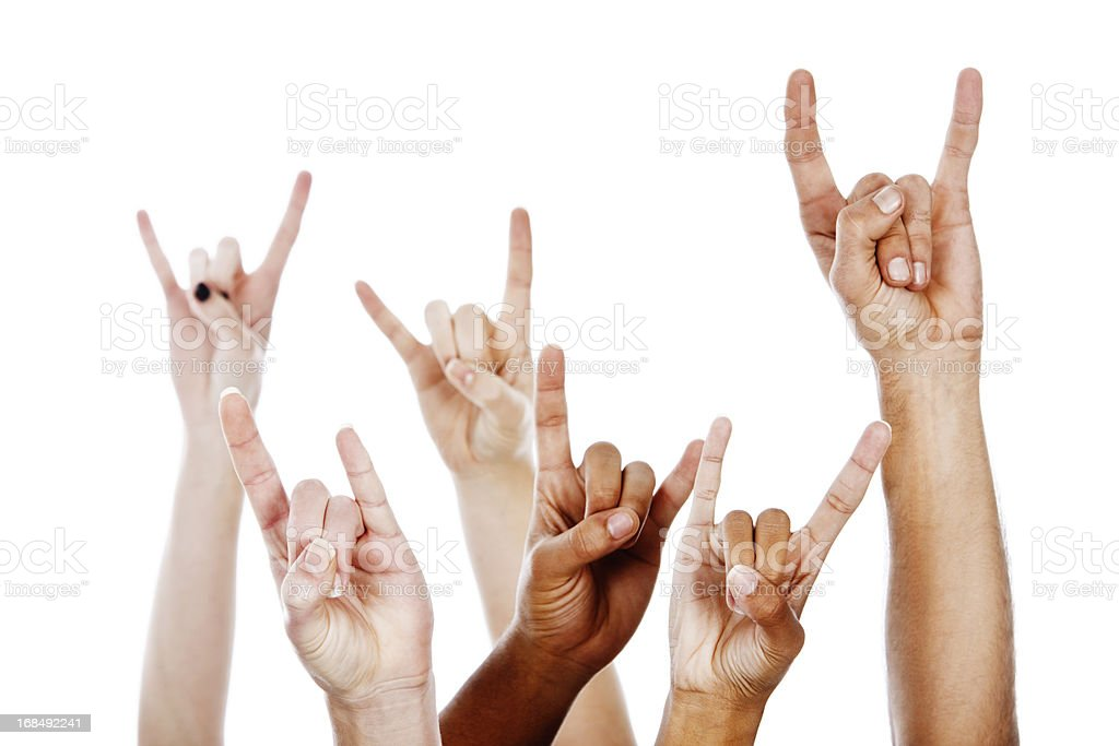 Rock on! Multiracial devil horns hand sign stock photo