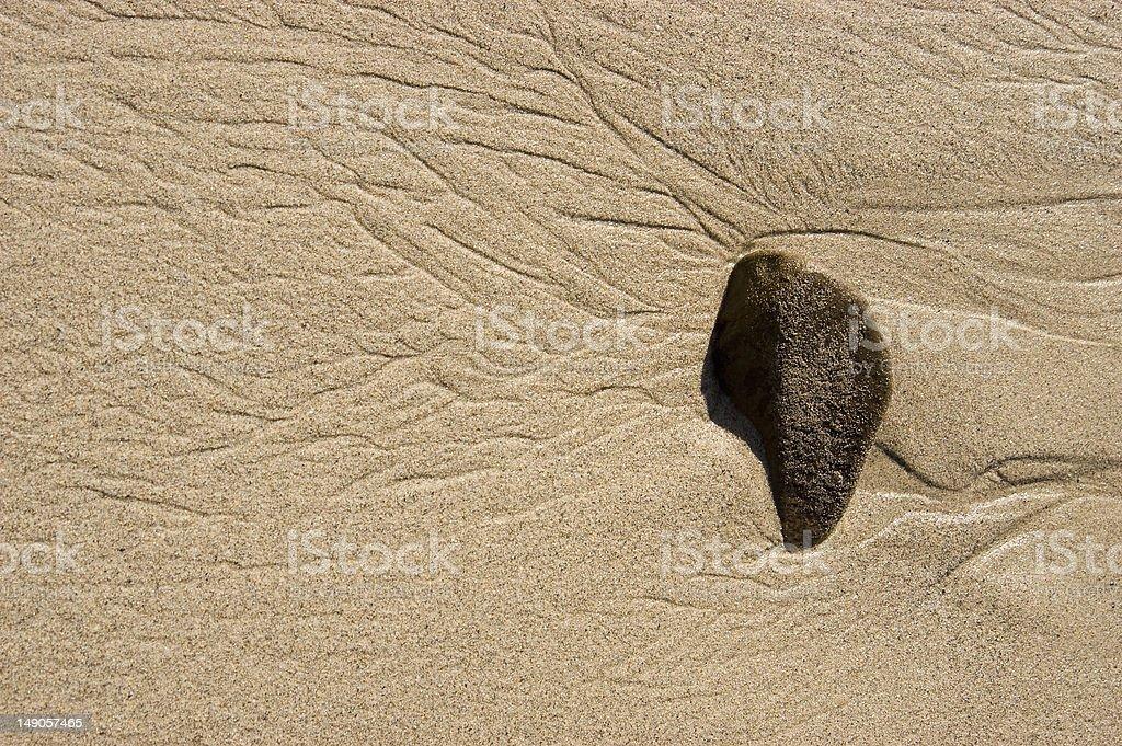 rock on sandy beach royalty-free stock photo