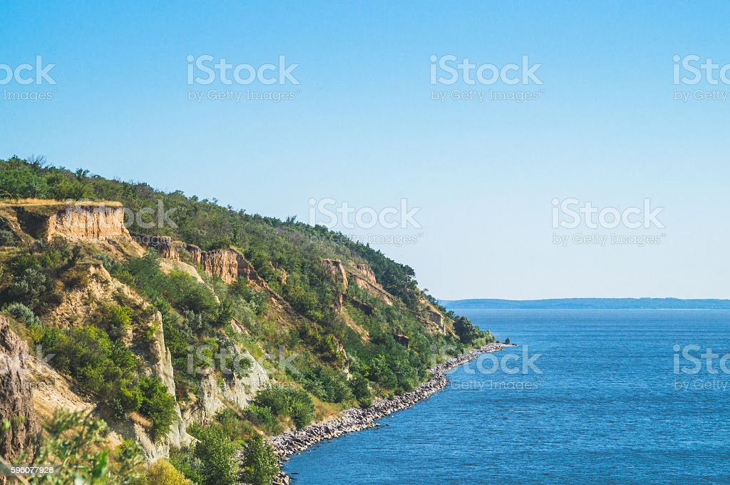 Rock on the river Bank. Erosion of soil stock photo