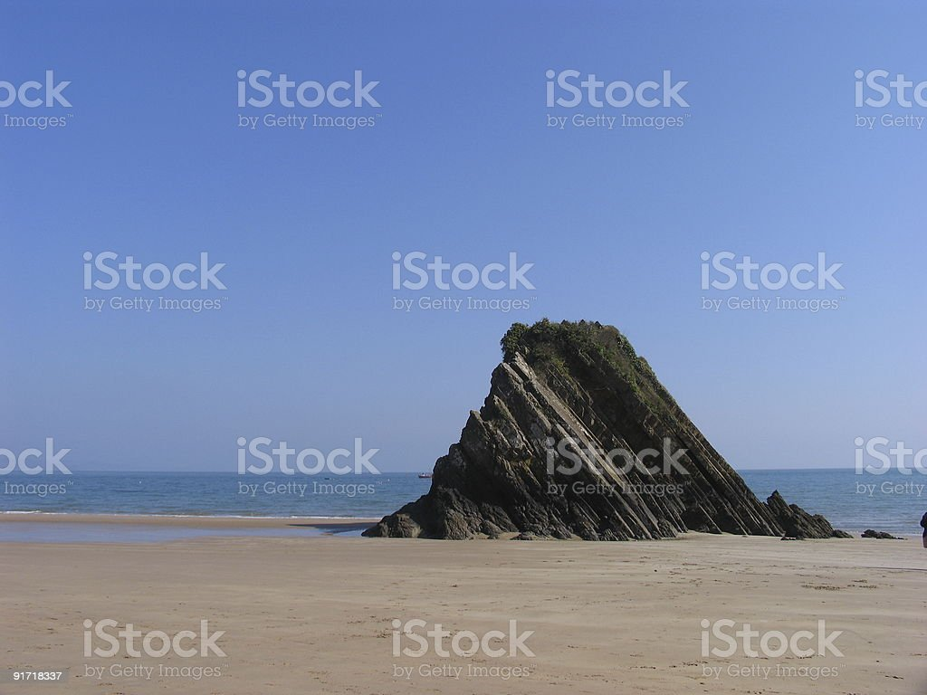 Rock on the seaside of Tenby in Wales stock photo
