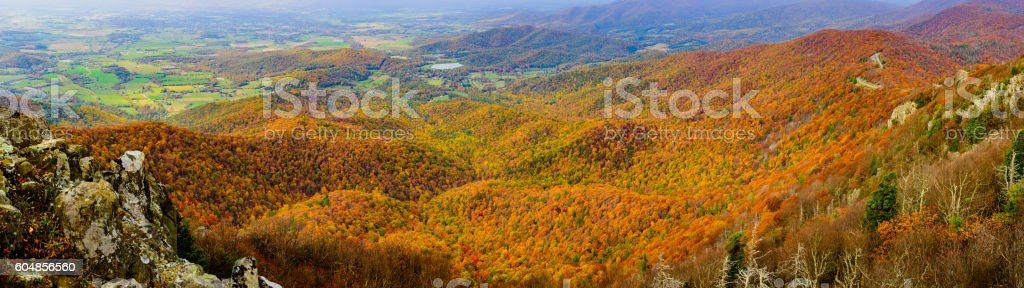 Rock outcroppings frame the autumn forest stock photo