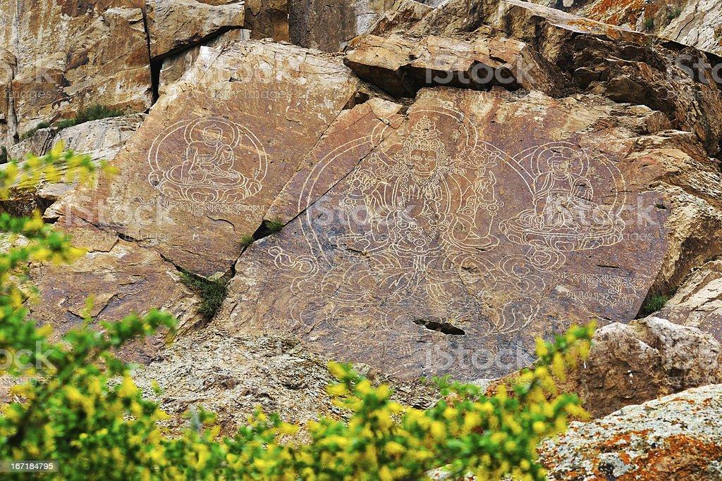 Rock paintings of Buddha in Kazakhstan royalty-free stock photo