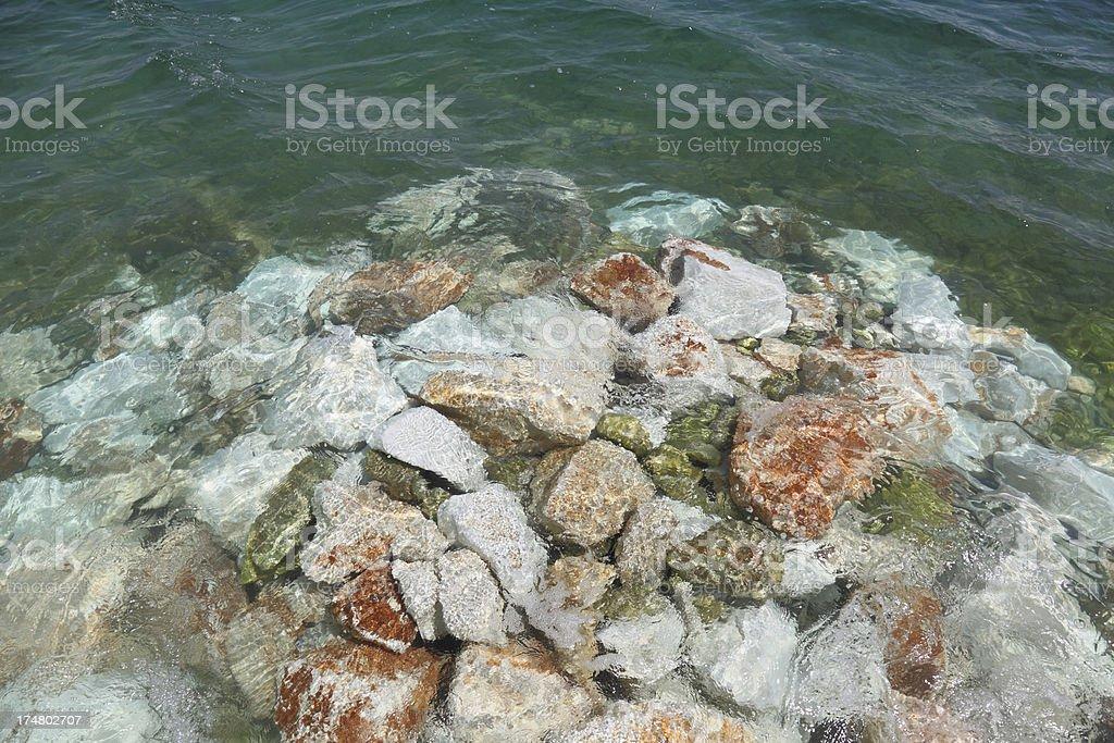 rock pile in  turquoise blue mediterranean ocean Trogir Croatia royalty-free stock photo
