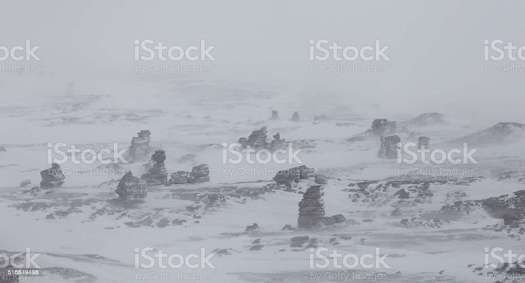 Rock pillars on Severnaya Zemlya aerial view in blizzard conditions stock photo
