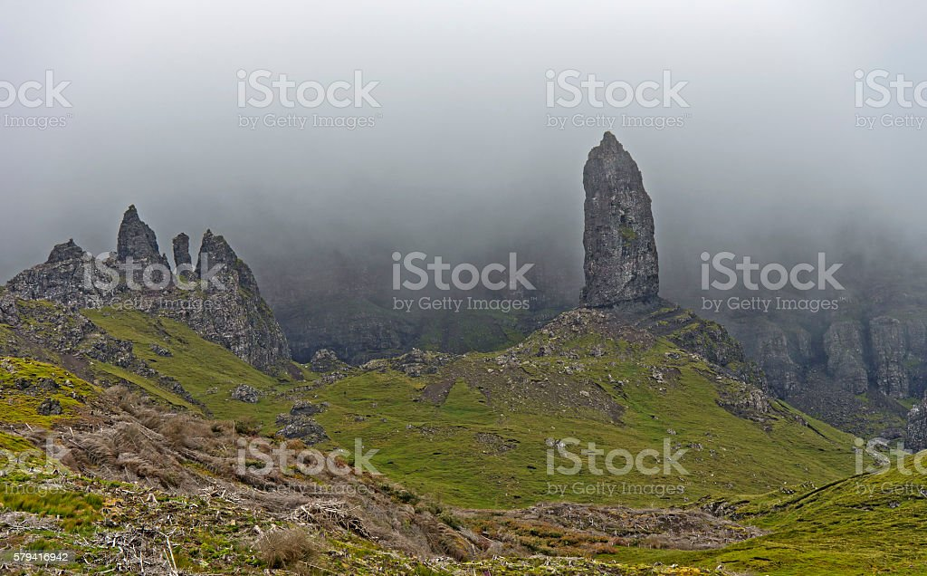 Rock pinnacle The Old Man of Storr in the fog stock photo