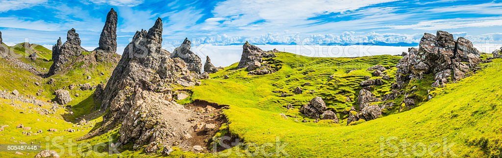 Rock pinnacles of The Storr above clouds Skye Highlands Scotland stock photo