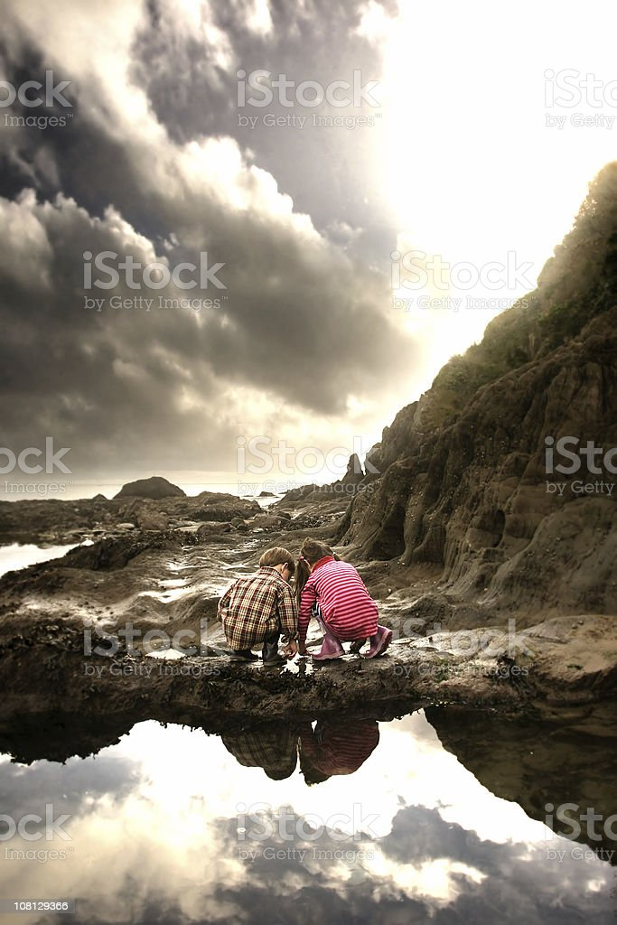 Rock pool kids stock photo