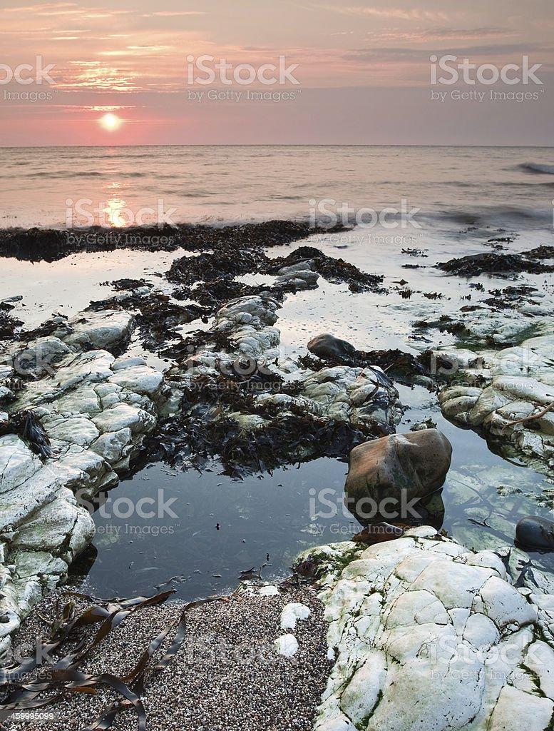 Rock pools at sunrise stock photo
