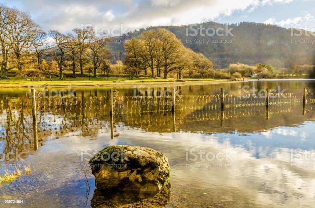 Rock reflected in Derwentwater stock photo
