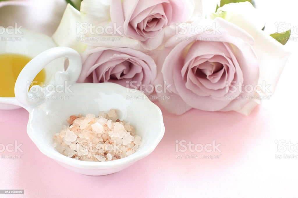 rock salt and masage oil with purple roses on background royalty-free stock photo