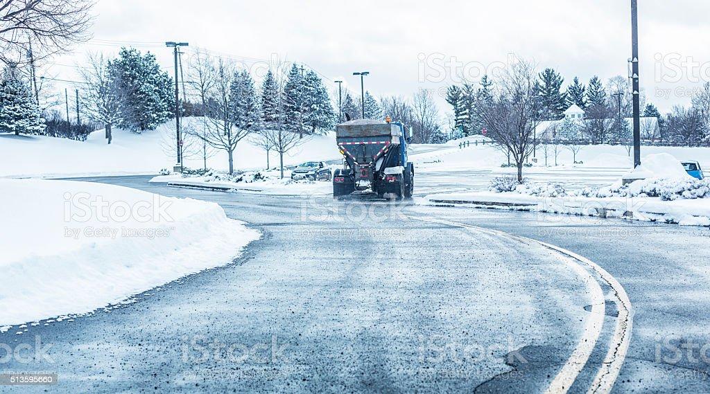 Rock Salt Spreader Dump Truck Salting Retail Mall Parking Lot stock photo