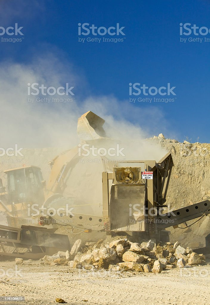 Rock Screener and Loader at a Quarry Site stock photo