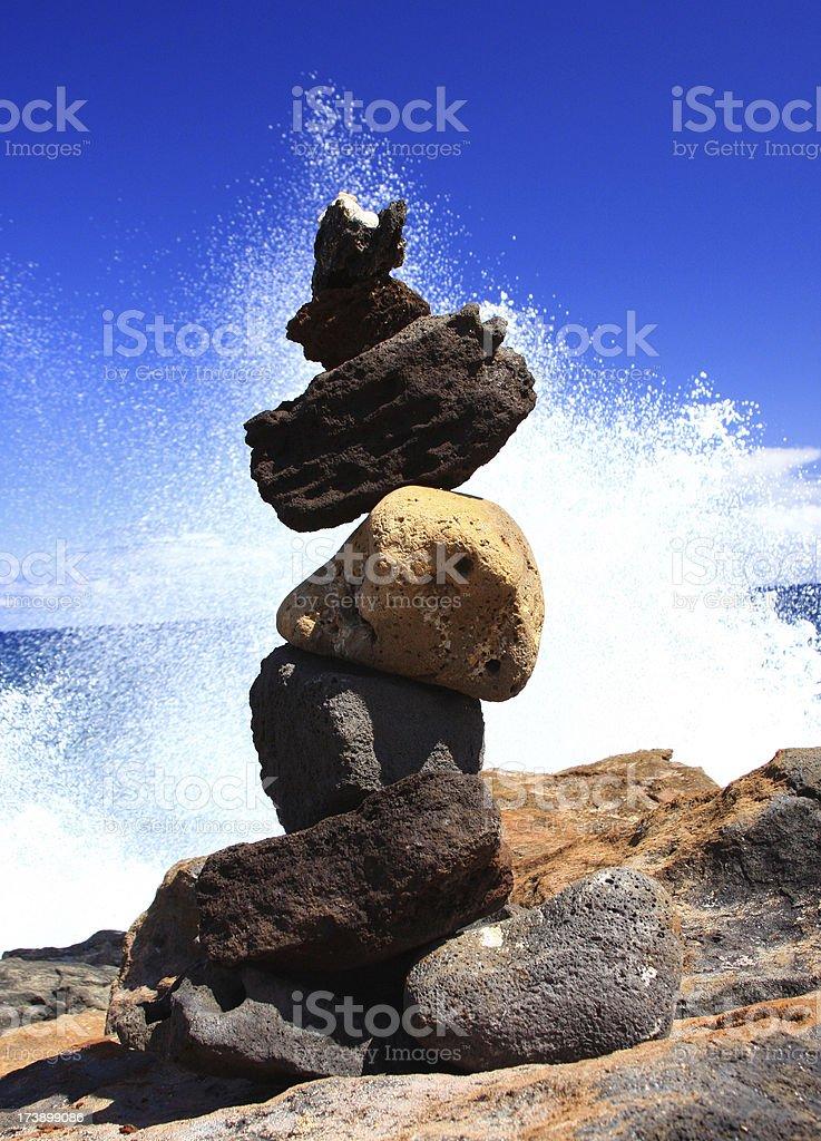 Rock sculpture on Hawaii beach coast line stock photo