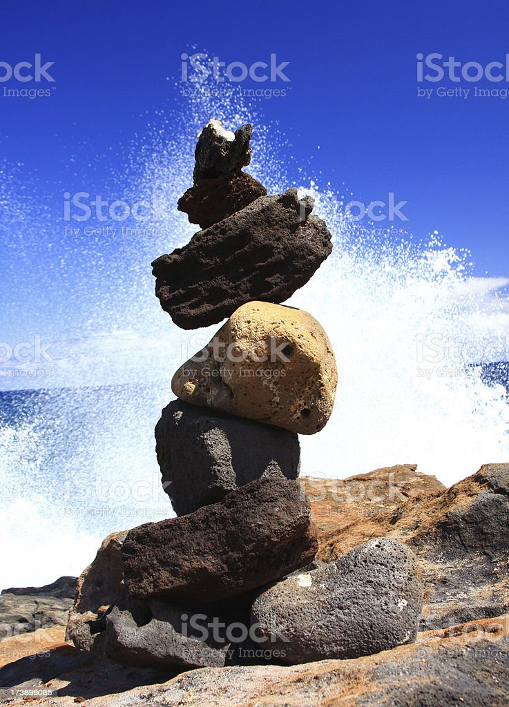 Rock sculpture on Hawaii beach coast line stock photo