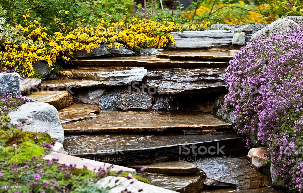 Rock Slab Fountain With Professional Landscaping stock photo