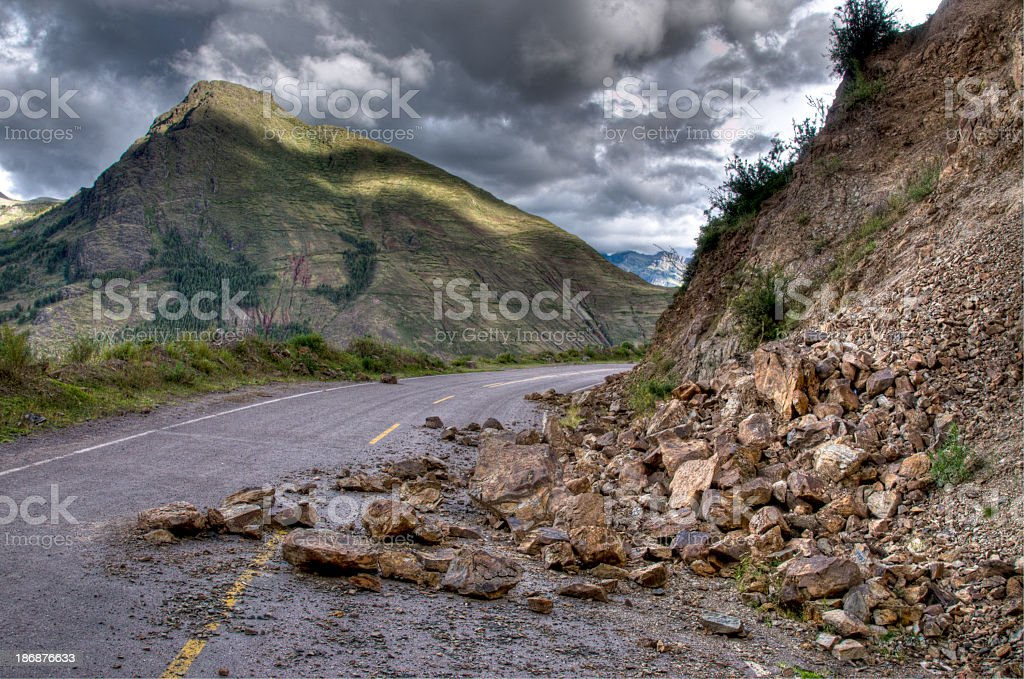 Rock slide with damage on the road during a storm stock photo