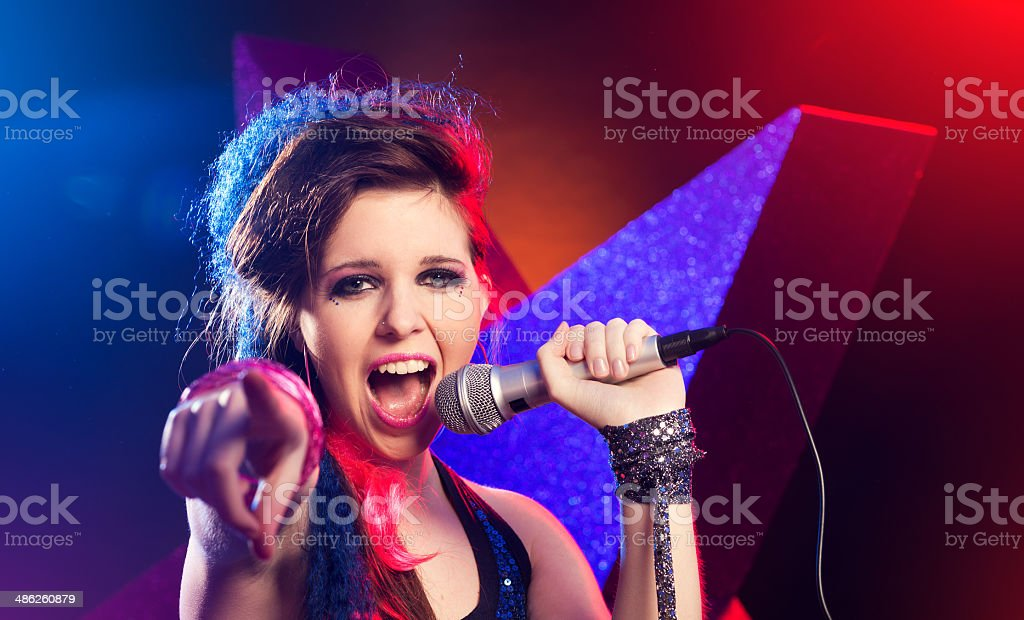 Rock star singing on stage stock photo