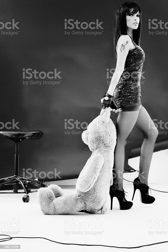 Rock Star Woman Dragging Large Teddy Bear royalty-free stock photo