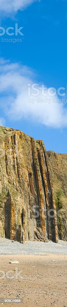 Rock strata on beach cliff stock photo