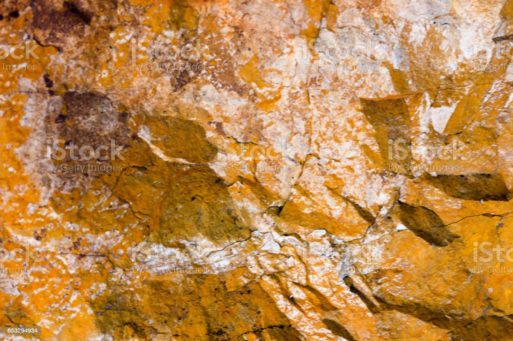 Rock texture and surface background. Cracked and weathered natural stone background. stock photo
