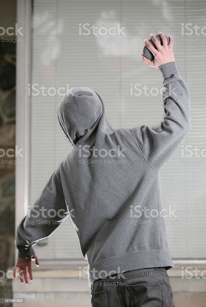 Rock Thrower and Window ( Mid-throw) - 4 stock photo