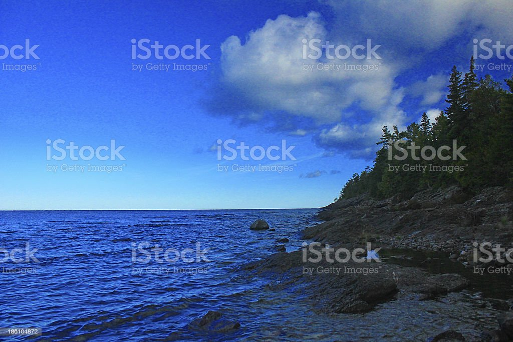 Rock trees water sky royalty-free stock photo