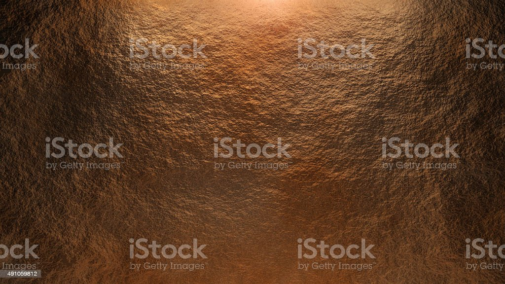 Rock wall background gold stock photo