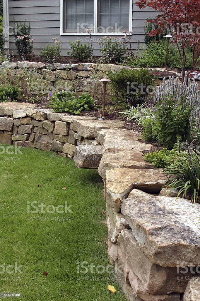 Rock Wall Backyard Landscaping Project stock photo