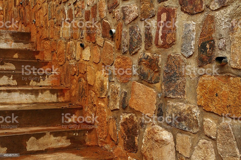 Rock Wall  with Drainage Pipes and Staircase stock photo
