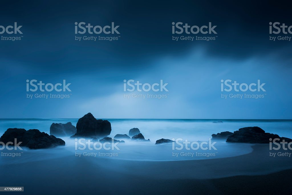 Rock, wave and wind stock photo
