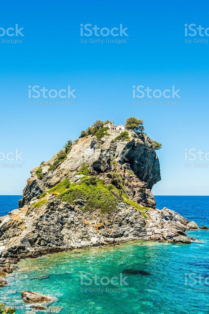 Rock with Agios Ioannis church on Skopelos island stock photo
