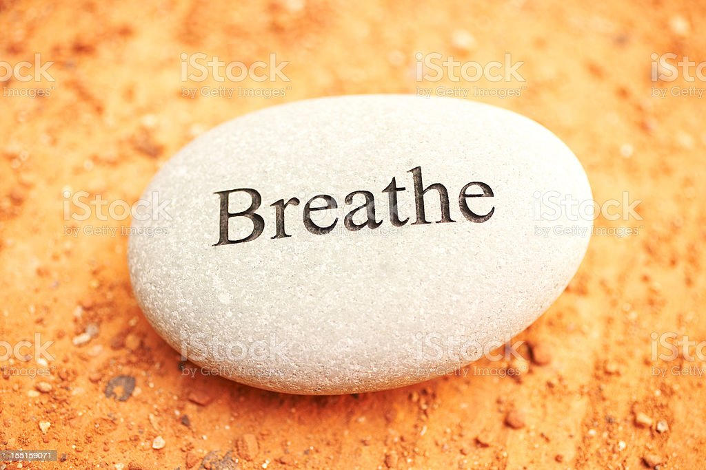 Rock with breathe written on it. stock photo