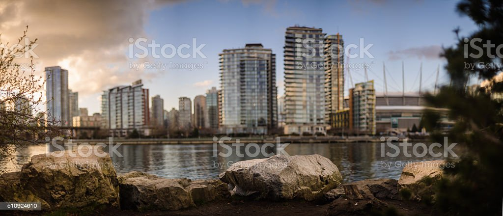 Rock with Commercial Buildings in Background stock photo